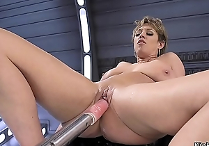 Busty Milf rides monster dildos and machine