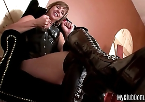 domina is posing in sexy leather boots and talking about masturbatio