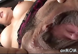 Two guys get their asses  finger fucked and licked hard by immodest mom