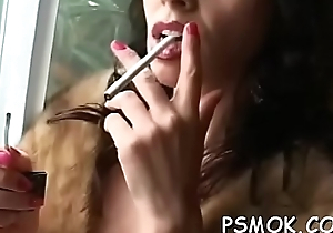 This gorgeous babe is looking so sexy while smokin'_