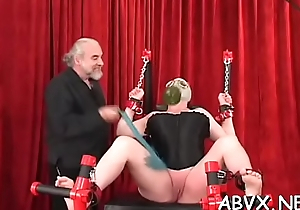 Sexy female fucked and stimulated in extraordinary bondage