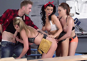 Romi Rain and her factory colleagues work together on one XXX bulge