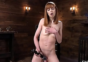 Skinny redhead fucks machine in shoes
