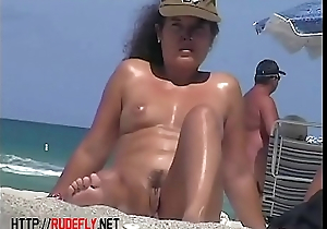 Hot blondie in be transferred to nude beach voyeur video